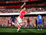 Olivier Giroud of Arsenal celebrates as he scores their first goal during the Barclays Premier League match between Arsenal and Everton at Emirates Stadium on March 1, 2015