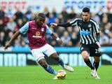 Jores Okore of Aston Villa and Emmanuel Riviere of Newcastle United battle for the ball during the Barclays Premier League match between Newcastle United and Aston Villa at St James' Park on February 28, 2015