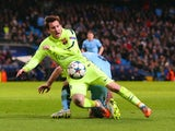 Lionel Messi of Barcelona draws a foul from Pablo Zabaleta of Manchester City in the area to win a penalty during the UEFA Champions League Round of 16 match between Manchester City and Barcelona at Etihad Stadium on February 24, 2015