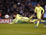 Barcelona's Argentinian forward Lionel Messi heads the ball wide off the rebound from his penalty that was saved by Manchester City's English goalkeeper Joe Hart during the UEFA Champions League round of 16 first leg football match between Manchester City