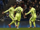 Barcelona's Uruguayan forward Luis Suarez celebrates scoring the opening goal with Barcelona's Brazilian defender Dani Alves and Barcelona's Argentinian forward Lionel Messi during the UEFA Champions League round of 16 first leg football match between Man