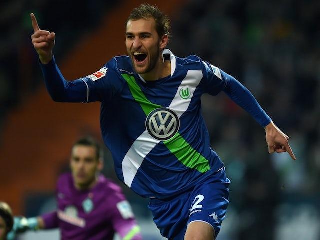 Wolfsburg's Dutch striker Bas Dost celebrates during the German first division Bundesliga football match SV Werder Bremen vs VfL Wolfsburg in Bremen, western Germany, on March 1, 2015