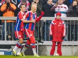 Bayern Munich's Dutch midfielder Arjen Robben celebrates scoring with Bayern Munich's Brazilian defender Rafinha during the German first division Bundesliga football match FC Bayern Munich vs 1 FC Cologne in Munich, southern Germany, on February 27, 2015