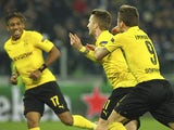 Marco Reus of Borussia Dortmund celebrates his goal with his team-mate Ciro Immobile (R) during the UEFA Champions League Round of 16 match between Juventus and Borussia Dortmund at Juventus Arena on February 24, 2015