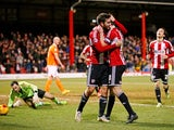 Jon Toral of Brentford is congratulated by teammate Jonathan Douglas of Brentford after scoring the opening goal during the Sky Bet Championship match between Brentford and Blackpool at Griffin Park on February 24, 2015