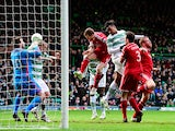 Celtic player Jason Denayer heads the opening goal during the Scottish Premiership match between Celtic and Aberdeen at Celtic Park Stadium on March 1, 2015