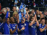 John Terry of Chelsea lifts the Capital One Cup trophy during the Capital One Cup Final match between Chelsea and Tottenham Hotspur at Wembley Stadium on March 1, 2015