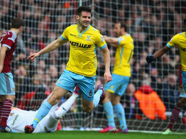 Scott Dann of Crystal Palace celebrates as he scores their second goal during the Barclays Premier League match between West Ham United and Crystal Palace at Boleyn Ground on February 28, 2015