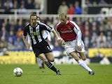Dennis Bergkamp of Arsenal looks to go past Andy O''Brien (left) of Newcastle United during the FA Barclaycard Premiership match played at St James Park, in Newcastle on March 2, 2002