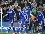 Diego Costa of Chelsea celebrates with team mates after his shot on goal is deflected in for a second by Kyle Walker of Spurs during the Capital One Cup Final match on March 1, 2015