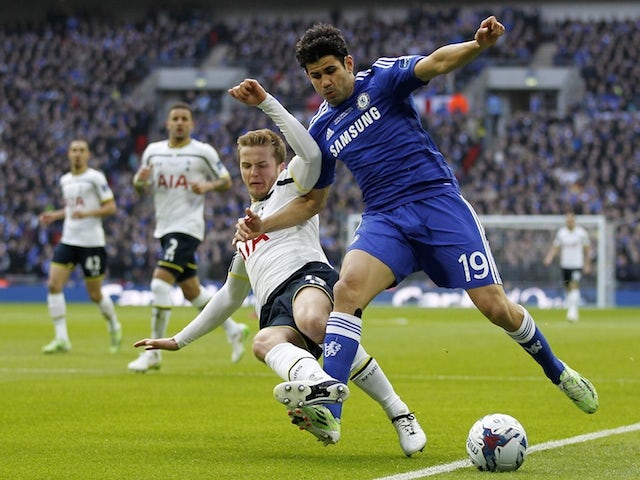 Tottenham Hotspur's English defender Eric Dier (L) vies with Chelsea's Brazilian-born Spanish striker Diego Costa during the English League Cup Final football match on March 1, 2015