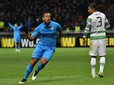 Inter Milan's midfielder from Colombia Fredy Guarin celebrates after scoring a goal during the UEFA Europa League football match Inter Milan vs Celtic FC on February 26, 2015