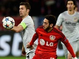 Atletico Madrid's midfielder Gabi and Leverkusen's midfielder Hakan Calhanoglu (R) vie for the ball during the UEFA Champions League first-leg, round of 16 football match on February 25, 2015