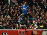 Monaco's French midfielder Geoffrey Kondogbia celebrates scoring the opening goal during the UEFA Champions League round of 16 first leg football match against Arsenal  on February 25, 2015