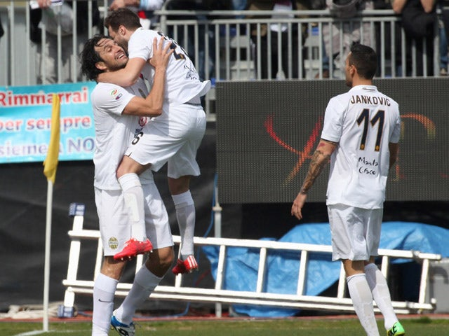 Luca Toni of Verona celebrates with team-mates after scoring their first goal during the Serie A match between Cagliari Calcio and Hellas Verona FC at Stadio Sant'Elia on March 1, 2015