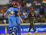 India's Rohit Sharma embraces teammate Virat Kohli after their win during the 2015 Cricket World Cup Pool B match between the UAE and India in Perth on February 28, 2015