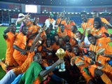 Ivory Coast's players celebrate with the trophy at the end of the 2015 African Cup of Nations final football match between Ivory Coast and Ghana in Bata on February 8, 2015