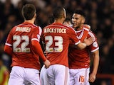 Jamaal Lascelles (r) of Nottingham Forest is congratulated on scoring the equalising goal during the Sky Bet Championship match against Bournemouth on February 25, 2015