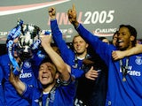 Chelsea's captain John Terry holds up the Carling Cup trophy with his teammates after defeating Liverpool in the Carling Cup Final football match  on February 27, 2005