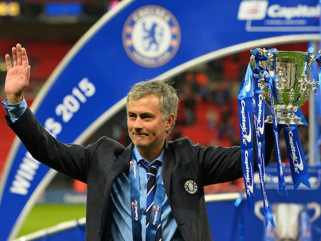 Chelsea's Portuguese manager Jose Mourinho celebrates with the trophy during the presentation after Chelsea won the League Cup final football match against Tottenham Hotspur at Wembley Stadium on March 1, 2015