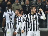 Juventus' Spanish forward Alvaro Morata celebrates after scoring during the UEFA Champions League round of 16 first leg football match Juventus vs Borussia Dortmund at the Juventus stadium in Turin on February 24, 2015
