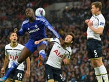 Chelsea's French defender Kurt Zouma (2nd L) vies with Tottenham Hotspur's English midfielder Ryan Mason (2nd L) during the English League Cup Final football match on March 1, 2015