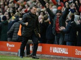 Liverpool's Northern Irish manager Brendan Rodgers celebrates at the final whistle in the English Premier League football match between Liverpool and Manchester City at Anfield stadium in Liverpool, north west England, on March 1, 2015