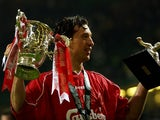 Liverpool's Robbie Fowler holds aloft The Worthington Cup and Man of the Match trophies after beating Birmingham City at The Millenium Stadium in Cardiff Sunday 25 February 2001