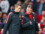 Manager Louis van Gaal of Manchester United speaks to Adnan Januzaj of Manchester United atr half time during the Barclays Premier League match between Manchester United and Sunderland at Old Trafford on February 28, 2015