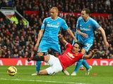 Radamel Falcao of Manchester United is brought down in the area by Wes Brown and John O'Shea of Sunderland to win a penalty during the Barclays Premier League match between Manchester United and Sunderland at Old Trafford on February 28, 2015