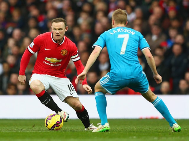 Wayne Rooney of Manchester United is closed down by Sebastian Larsson of Sunderland during the Barclays Premier League match between Manchester United and Sunderland at Old Trafford on February 28, 2015