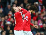 Wayne Rooney of Manchester United celebrates scoring their second goal during the Barclays Premier League match between Manchester United and Sunderland at Old Trafford on February 28, 2015