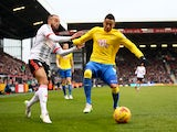 Marcello Trotta of Fulham tries to tackle Paul Coutts of Derby County during the Sky Bet Championship match on February 28, 2015