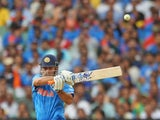 MS Dhoni of India edges the ball and is out caught behind during the 2015 ICC Cricket World Cup match between South Africa and India at Melbourne Cricket Ground on February 22, 2015