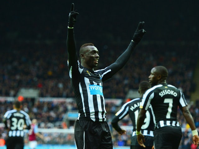 Papiss Demba Cisse of Newcastle United celebrates scoring the opening goal during the Barclays Premier League match between Newcastle United and Aston Villa at St James' Park on February 28, 2015