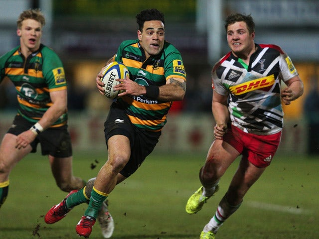 Kahn Fotuali'i of Northampton Saints breaks away from Harry Sloan of Harlequins during the Aviva Premiership match between Northampton Saints and Harlequins at Franklin's Gardens on February 27, 2015