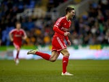 Gary Gardner of Nottingham Forest celebrates scoring the third goal during the Sky Bet Championship match between Reading and Nottingham Forest at Madejski Stadium on February 28, 2015