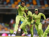 Wahab Riaz of Pakistan celebrates with team mates after taking the wicket of Tewanda Mupariwa of Zimbabwe during the 2015 ICC Cricket World Cup match between Pakistan and Zimbabwe at The Gabba on March 1, 2015