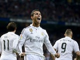 Real Madrid's Portuguese forward Cristiano Ronaldo celebrates after scoring on a penalty kick during the Spanish league football match Real Madrid CF vs Villarreal CF at the Santiago Bernabeu stadium in Madrid on March 1, 2015