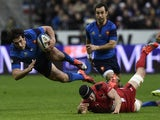 France's centre Remi Lamerat falls after being tackled during the Six Nations international rugby union match between France and Wales on February 28, 2015
