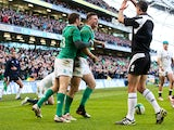 Robbie Henshaw of Ireland is congratulated by teammate Jared Payne of Ireland after scoring the opening try during the RBS Six Nations match on March 1, 2015