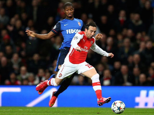 Santi Cazorla of Arsenal is challenged by Almary Toure of Monaco during the UEFA Champions League round of 16, first leg match  on February 25, 2015