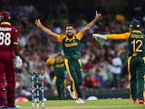 South Africa's spin bowler Imran Tahir celebrates his wicket of West Indies batsman Darren Sammy (L) during the 2015 Cricket World Cup Pool B match between South Africa and the West Indies at the Sydney Cricket Ground on February 27, 2015