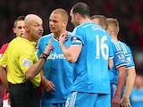 Wes Brown of Sunderland reacts after being shown a straight red card by Refere Roger East as John O'Shea of Sunderland appeals during the Barclays Premier League match between Manchester United and Sunderland at Old Trafford on February 28, 2015