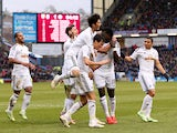 Jack Cork of Swansea City is congratulated by teamates after his shot is deflected for an own goal during the Barclays Premier League match between Burnley and Swansea City at Turf Moor on February 28, 2015