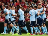Marc Janko of Sydney FC celebrates with team mates after scoring a goal during the round 19 A-League match between the Western Sydney Wanderers and Sydney FC at Pirtek Stadium on February 28, 2015