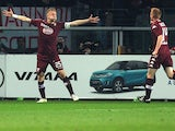 Torino's Polish defender Kamil Glik celebrates after scoring during the Italian Serie A football match Torino Vs Napoli on March 1, 2015