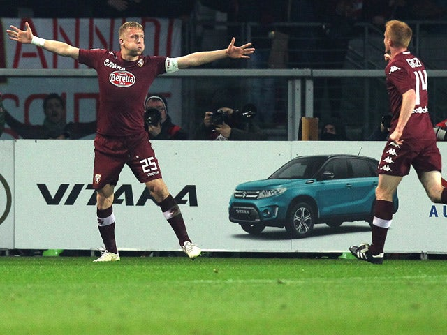 Torino's Polish defender Kamil Glik celebrates after scoring during the Italian Serie A football match Torino Vs Napoli on March 1, 2015