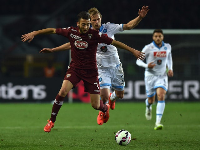 Omar El Kaddouri of Torino FC clashes with Ivan Strinic of SSC Napoli during the Serie A match between Torino FC and SSC Napoli at Stadio Olimpico di Torino on March 1, 2015