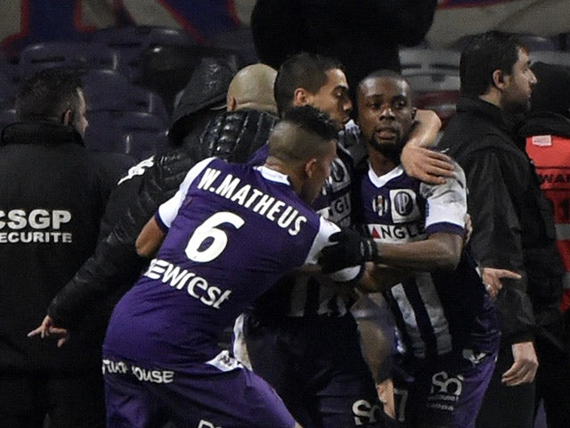 Toulouse's French Ivorian defender Jean Akpa-Akpro celebrates with teammates after scoring a goal during the French L1 football match Toulouse vs Saint Etienne February 28, 2015